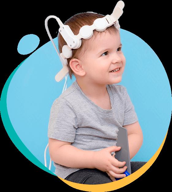 Ребенок в сеансе лечения аутизма