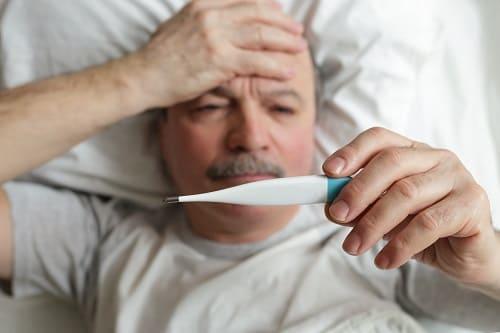 Давящая головная боль и температура